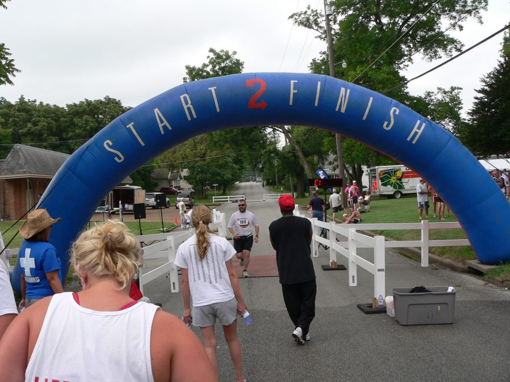 Crossing the finish line at my first triathlon, the Mighty Mite!